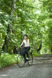 Girl riding a bicycle Stock Photos