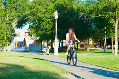 Girl riding on bicycle Stock Image