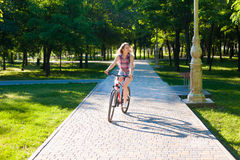 Girl riding on bicycle Royalty Free Stock Photography