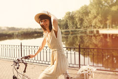 Girl riding a bicycle in park near the lake Royalty Free Stock Photography