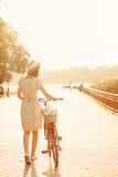 Girl riding a bicycle in park near the lake Stock Photo