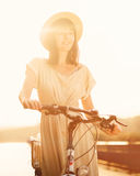 Girl riding a bicycle in park near the lake Stock Images