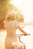 Girl riding a bicycle in park near the lake Royalty Free Stock Photos