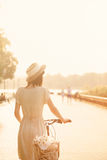 Girl riding a bicycle in park near the lake Royalty Free Stock Images