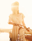 Girl riding a bicycle in park near the lake Stock Image