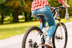 Girl riding a bicycle Stock Images