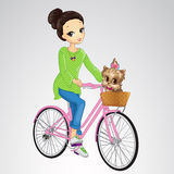Girl Riding Bicycle With Puppy Royalty Free Stock Photography