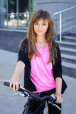 Girl riding a bicycle Royalty Free Stock Photography