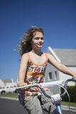 Girl Riding Bicycle On Street Royalty Free Stock Photo
