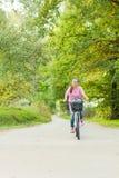 Girl riding bicycle Royalty Free Stock Image