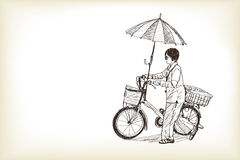 A girl riding bicycle to market and adapting umbrella on bicycl Royalty Free Stock Image