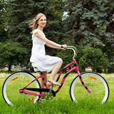 A girl riding a bicycle Stock Image