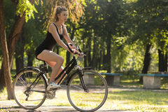 Girl riding a bike Royalty Free Stock Photo