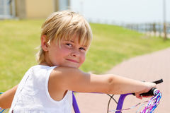 Girl riding bike Royalty Free Stock Photography