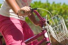 Girl riding bike Stock Photos