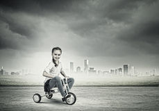 Girl riding bike Stock Photo