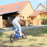 Girl riding a bike Stock Image