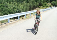 Girl riding a bike Stock Photography