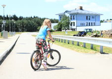 Girl riding a bike Royalty Free Stock Photos