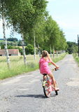 Girl riding a bike Royalty Free Stock Image