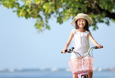 Girl riding bike outdoor Royalty Free Stock Image
