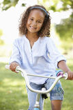 Girl Riding Bike In Park Stock Images