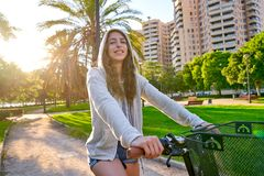 Girl riding bike in the park hoodie sweater royalty free stock photos