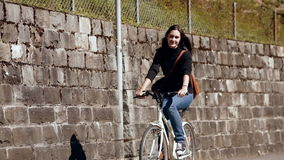 Girl riding a bike on the street stock video