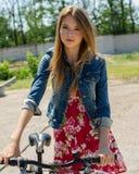 Girl riding a bike Stock Photo