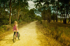 Girl riding bike royalty free stock image