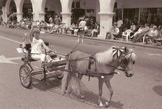 Girl riding buggy in Ojai Fourth of July Parade, Ojai, California Stock Image