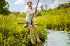Girl riding a bungee. Girl riding on the bungee in the summer sunny day Royalty Free Stock Image