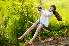 Girl riding a bungee. Girl riding on the bungee in the summer sunny day Stock Image