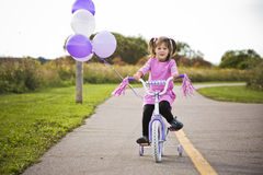 Girl riding a bycicle Stock Photo