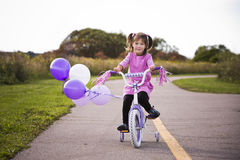 Girl riding a bycicle Stock Image