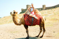 A girl riding a camel Royalty Free Stock Photos