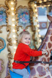 Girl riding on  carousel Royalty Free Stock Photo