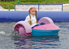 Girl riding on a child boat Royalty Free Stock Images