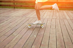 Girl riding cruiser on sunny day royalty free stock image