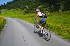Girl riding fast on bicycle Stock Photography