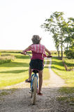 Girl riding fast on her bicycle Royalty Free Stock Photo