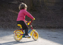 Girl riding first bike Stock Photo