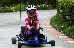 Girl riding go-kart Royalty Free Stock Image