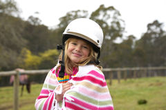 Girl with riding helmet Royalty Free Stock Photos