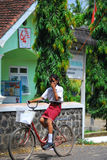 Girl riding her bicycle bike in Indonesia Stock Images