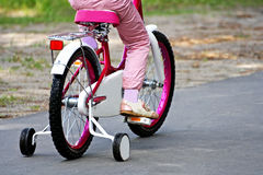 Girl riding her bike. Stock Photography