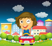 A girl riding with her toy car Stock Photos