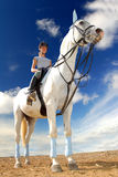 Girl riding a horse Stock Images