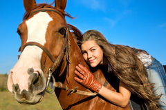 Girl riding a horse Royalty Free Stock Photo