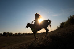 Girl riding a horse Royalty Free Stock Photos